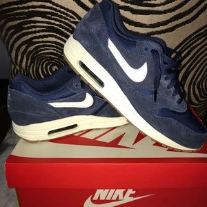 Navy Blue suede Nike shoes.